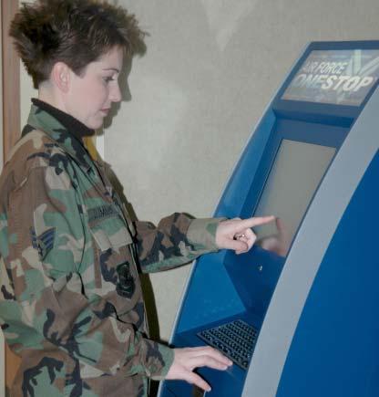 Senior Airman Vicki Cummings Using the OneStop Kiosk