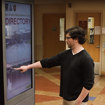 A man uses the wayfinding kiosk at BAMC